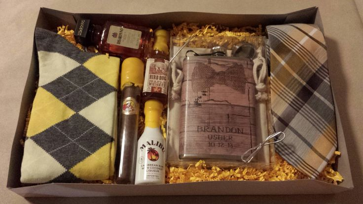 Groomsmen and Usher gifts!! So proud of our creativity.  Yellow Socks from Express  Flasks from 'Hair of The Dog' on Etsy Yellow Plaid tie from Macys The yellow wax on the bottles is bottle sealing wax from a beer making store. We melted the wax and dipped the bottles in.