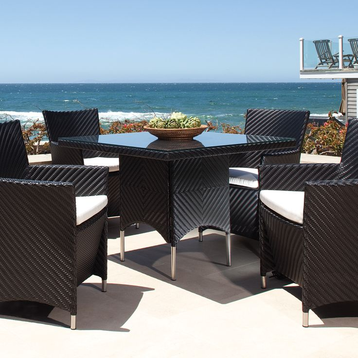 This Valencia dining table in Black color is truly an indoor-outdoor piece with style and functionality. Made of durable extruded polyethylene on powder coated high performance aluminum frame, the Valencia table is lightweight yet sturdy enough to withstand the rigors of everyday use and the extremities of outdoor weather including temperature fluctuations , UV exposure from sunlight, mold and mildew.