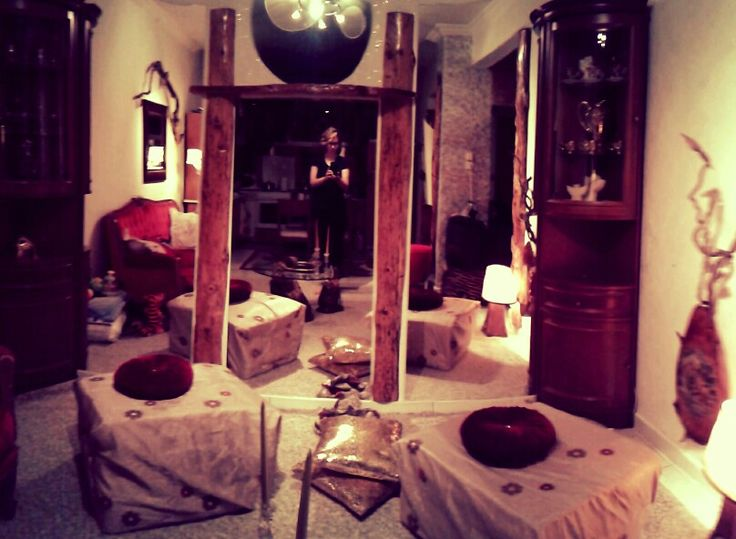 Here's my living room..Warm colours, ..full of glass ,rock , woods and mirrors!! Love it..