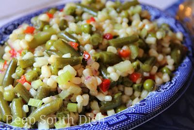 Marinated Vegetable Salad made with green beans, peas, white corn in a sweet & sour vinaigrette.