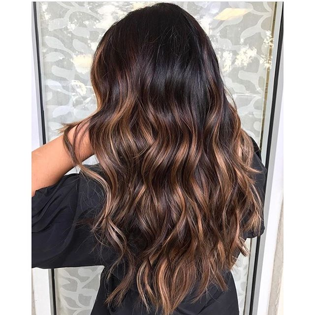 Rich Brunette with shiny sunkisses. Balayage