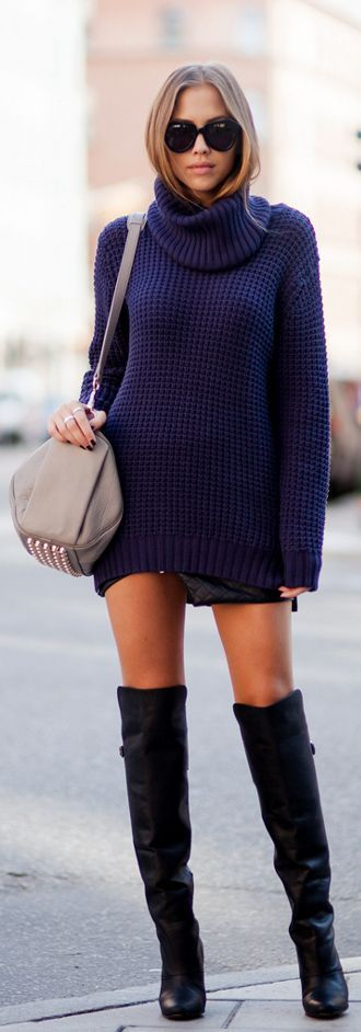 Choose a dark blue knit rollneck and a black quilted leather mini skirt for a comfortable outfit that's also put together nicely. Finish off your look with black leather over the knee boots.  Shop this look for $129:  http://lookastic.com/women/looks/sunglasses-turtleneck-crossbody-bag-mini-skirt-over-the-knee-boots/7186  — Black Sunglasses  — Navy Knit Turtleneck  — Grey Studded Leather Crossbody Bag  — Black Quilted Leather Mini Skirt  — Black Leather Over The Knee Boots