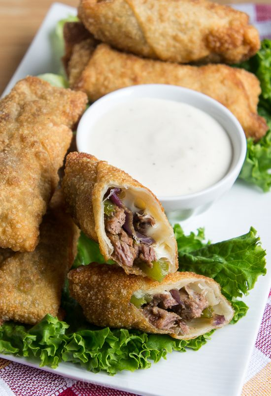 Philly Cheese Steak Egg Rolls with a creamy horseradish sauce! So easy and perfect for Super Bowl!!