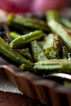 NYT Cooking: My friend Marian Schwartz gave me the idea to roast okra. It's an ingenious strategy: No need to marinate the okra in salt and vinegar beforehand -- it develops a wonderful seared flavor in the hot oven, and it won't be gooey.