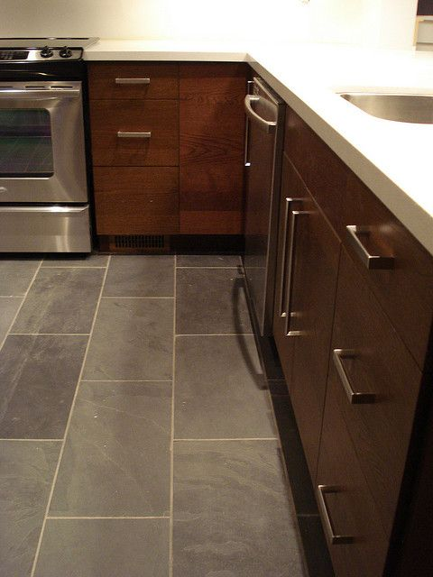 12 by 24 slate tile and dark wood cabinets--this is a good visual for where the tiles meets up with wood flooring