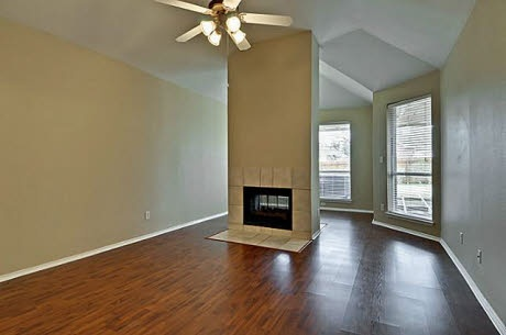Master Bedroom with see-through fire place to sitting area.