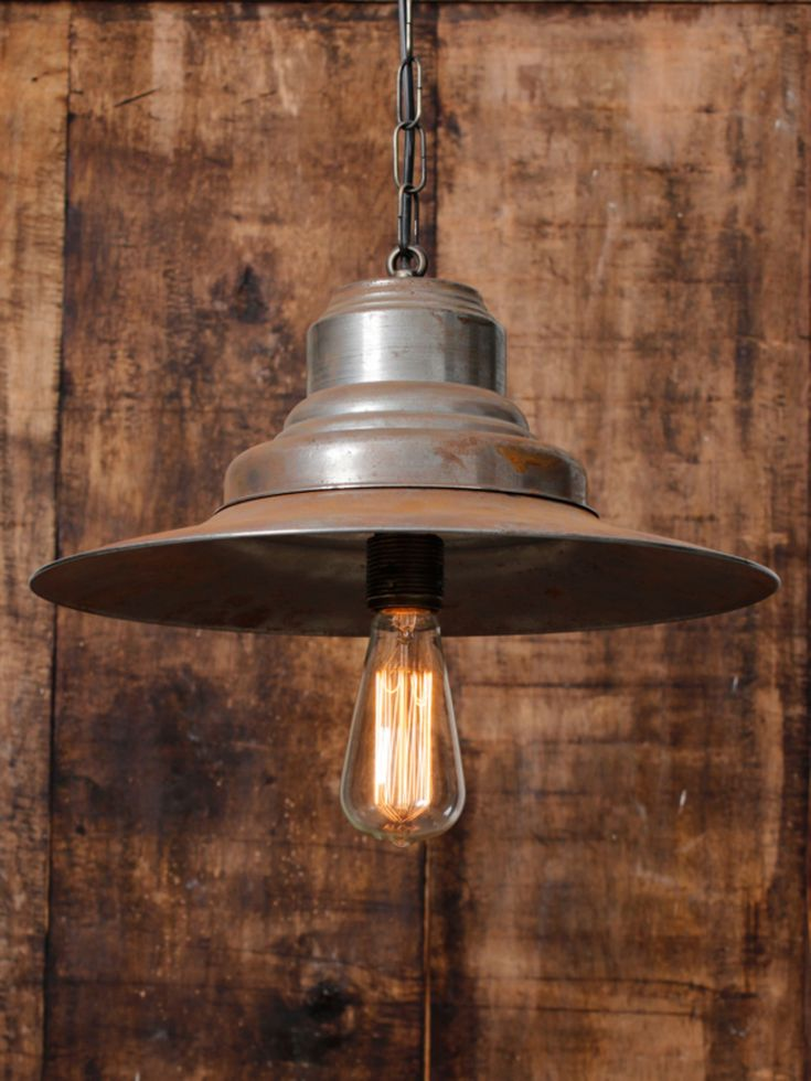 industrial lighting design. rusty spinning pendant vintagelight lighting design industrial