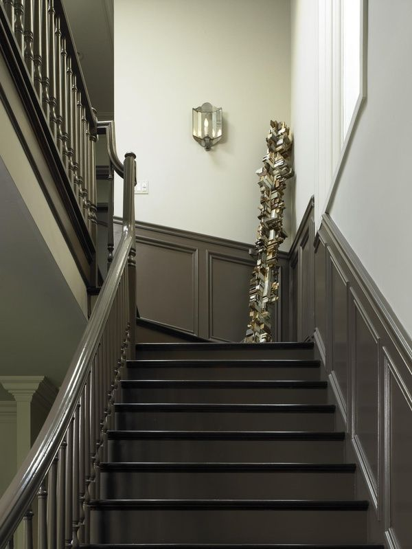 Greenish Gray painted paneling & stair railing.