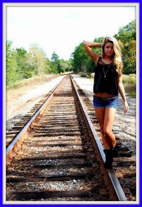 Cute girl on the tracks
