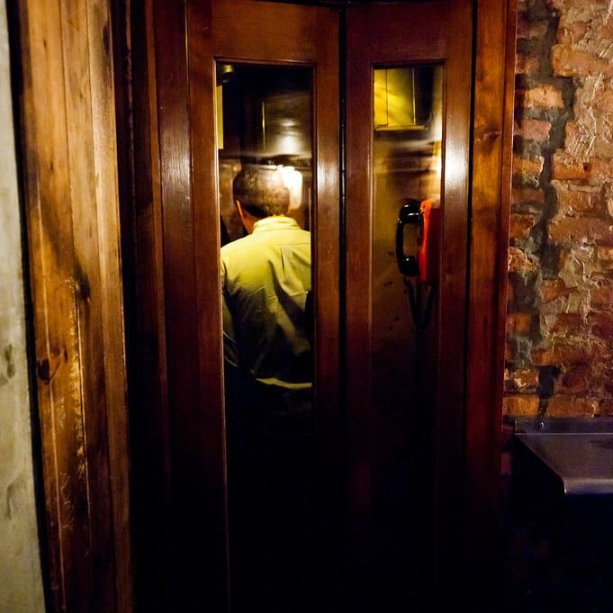 """East Village speakeasy, you actually go through a secret door inside a phone booth after giving them a ring. Enjoy the cozy atmosphere, awesome eats, and amazing drinks (the bacon-infused bourbon Old-Fashioned is a favorite). It's reservations only."""" 19 Bars In America You Should Drink At Before You Die"""