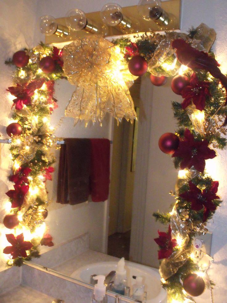 Poinsettia mirror garland for the bathroom. | #christmas #xmas #holiday #decorating #decor