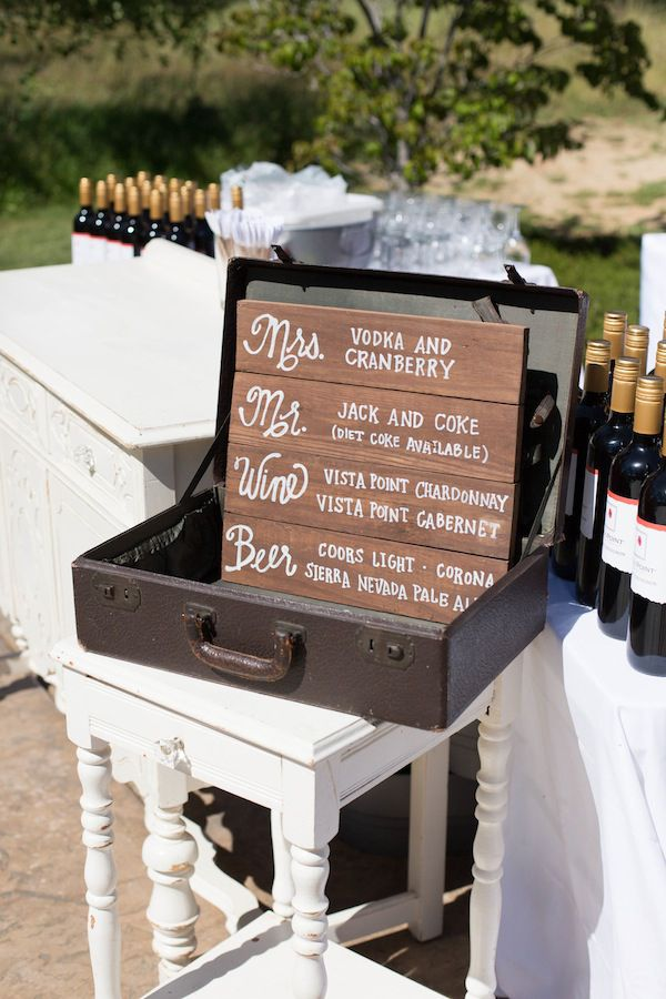 drink menu in vintage suitcase http://www.weddingchicks.com/2013/10/03/vintage-outdoor-wedding/