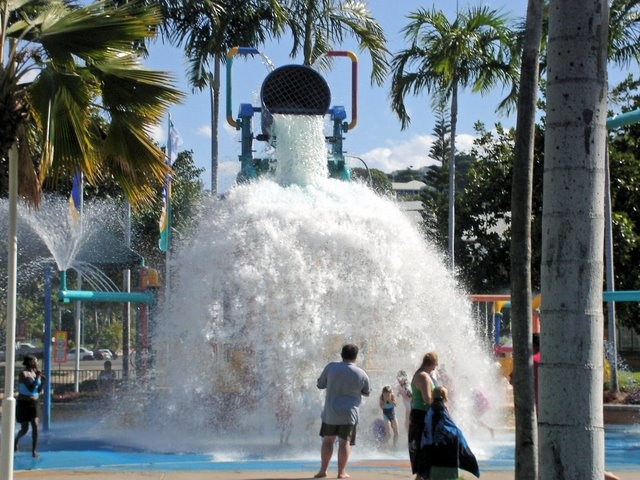 Water playground at Townsville, Queensland. Big bucket fills with water then tips. Photographed 2006.