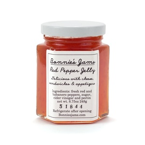 USD$12.95    A favourite among the American South, red pepper jelly is what your sandwich has been longing for. Thankfully Bonnie recognized this some time back and went ahead and concocted her own solution. Pairs well with any cheese platter, but really gets along well with goat cheese. Gives a heck of a kick to a simple turkey or cheddar sandwich.