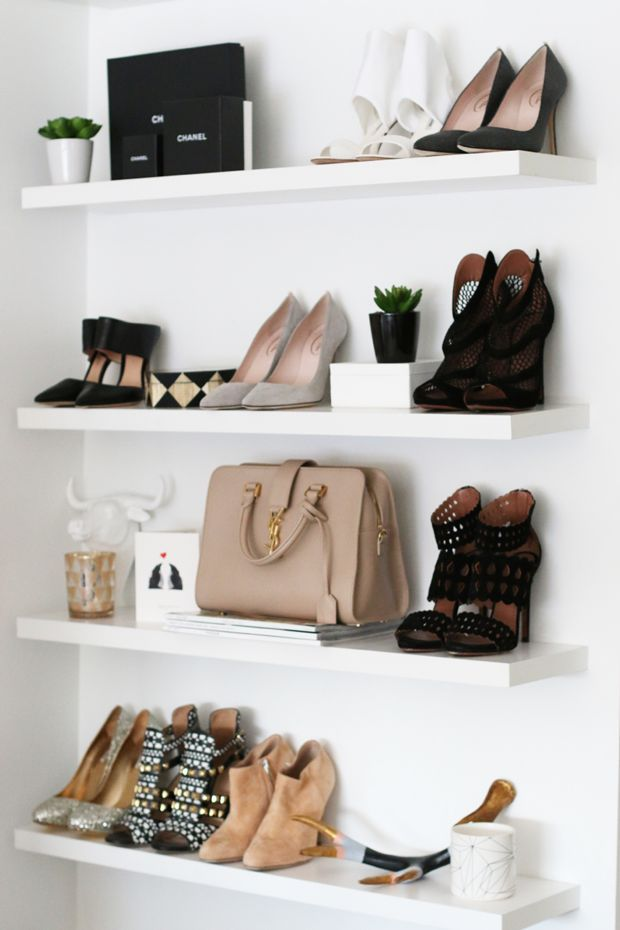 Floating shelves with bags and shoes on display
