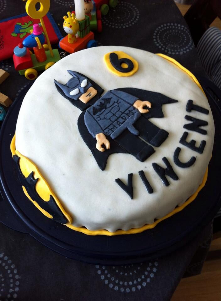 My son Vincent's 6th birthday cake. A Batman Lego cake with Oreo filling, banana in vanilla creme and raspberries. Cover with marzipan and sugar paste figures, logos and name.