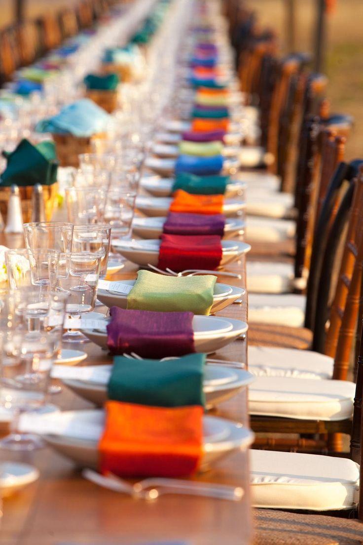 Vibrant linens, colorful napkins, bare farm table, outdoor wedding reception, jewel tones // Suzanne Karp Photography