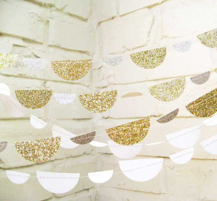The Petite Glam Scallop Garland for Baby Shower -Gold & Silver Glitter, $14.00, via Etsy.
