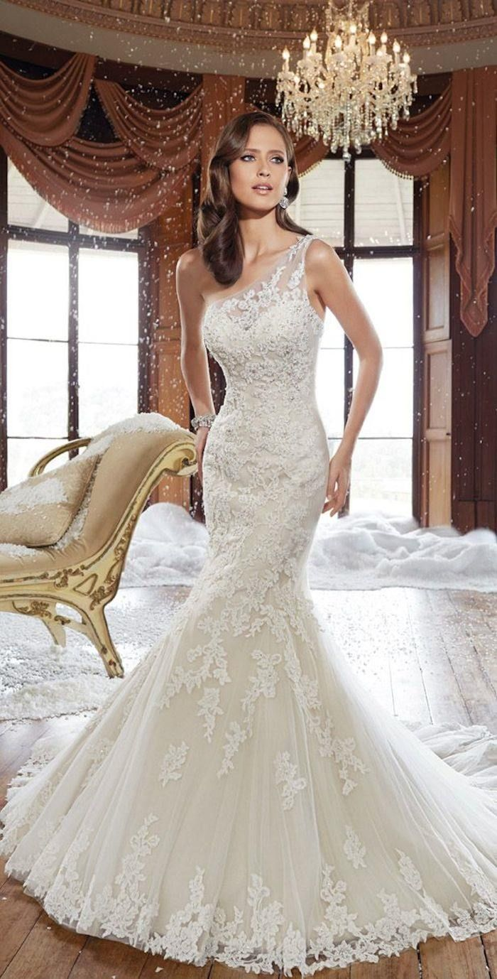 This Sophia Tolli wedding dress is to-die-for! We love the glamour! Photo via Belle the Magazine