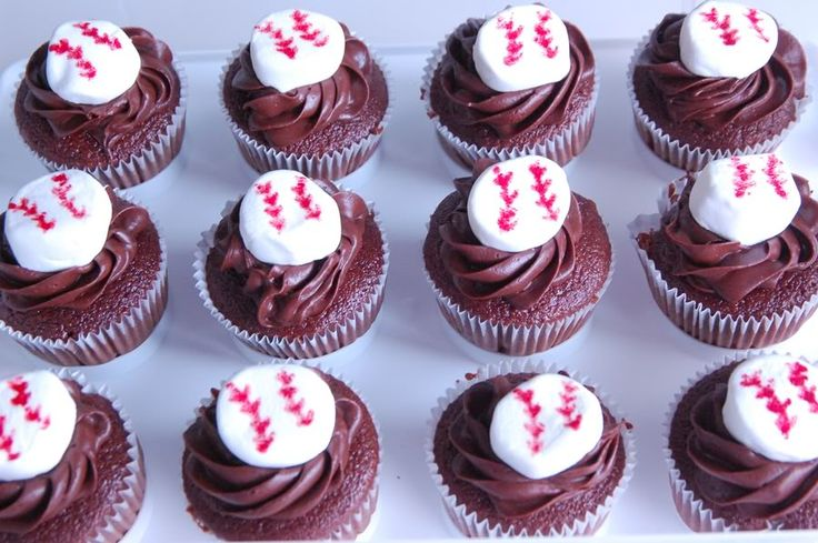 Baseball Cupcakes-frost, then cut a marshmallow in half and draw on lines with a food coloring pen