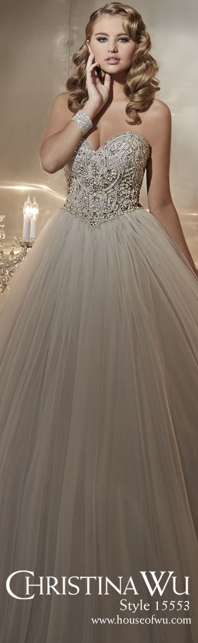 Shimmer in this romantic Christina Wu wedding gown with exquisite lace that adorns the strapless, sweetheart neckline, and crystal accents all along the fitted bodice create an elegant éclat. Lovely trim defines the flattering basque waistline, and the closely gathered skirt streams in gossamer layers to a flaring full-length and trailing train. #weddinggown