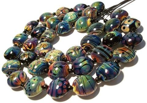 1) Make your bead in a neutral flame and apply your raku frit or stringer work…