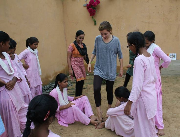 Volunteer playing with children in the foundation