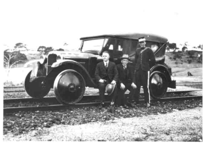 """at Callington (thought to be 1925/1926) performing South Australian Railways Payroll Escort Duty. The vehicle details are as follows:- DORT - M.I.C. (Mechanical Inspection Car) - Identification Number 114. 4 cylinders, 3 1\2 """" x 5"""" stroke; 19 Horse Power. Capacity 5 passengers + passenger luggage. Commenced service with S.A.R. 1923. Engine built by Lycoming Engines, Flint Michigan (USA), body work by Murray Aunger Motor Co. Flinders Street Adelaide. Original Cost £512.17.0."""