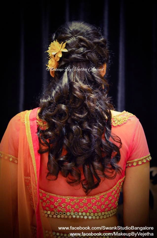 Indian bride's reception hairstyle by Vejetha for Swank Studio. Curls. Bridal lehenga. Hair Accessories. Tamil bride. Telugu bride. Kannada bride. Hindu bride. Malayalee bride. Find us at https://www.facebook.com/SwankStudioBangalore