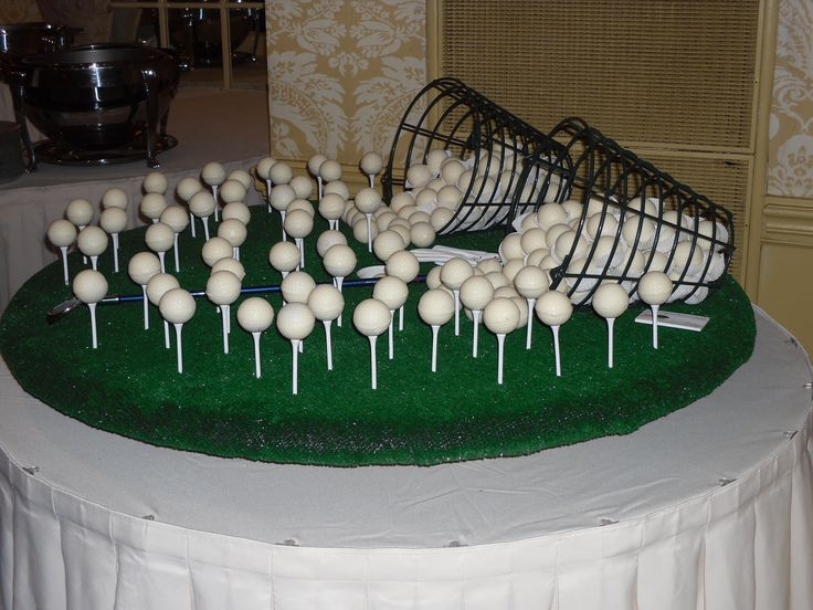 Golf Ball Cake Truffles on golf tees.
