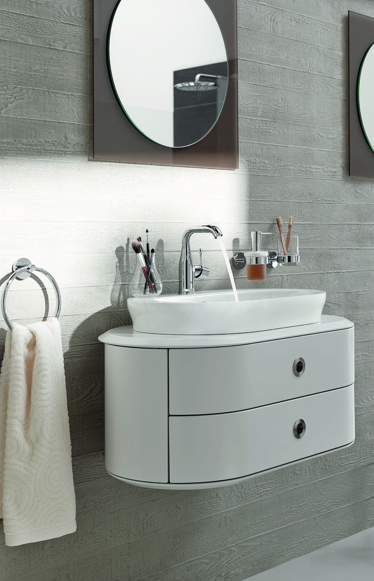 Keep everything off the floor for a clean, uncluttered and relaxing bathroom scheme. GROHE Essence bathrooms offer sanitary ware and fittings with perfectly aligned smooth lines for a delicately feminine edge to minimalism #minimal #basin #curves http://www.grohe.co.uk/en_gb/bathroom-collection/mixer-taps-essence.html
