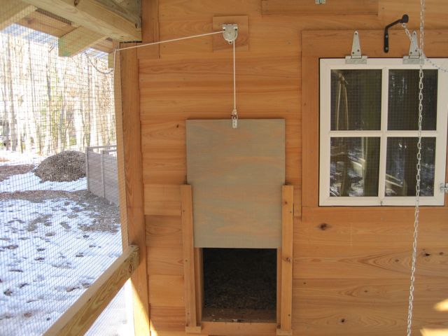 chicken coop door pully systems | What the coop looks like inside. We added power so we could have a ...