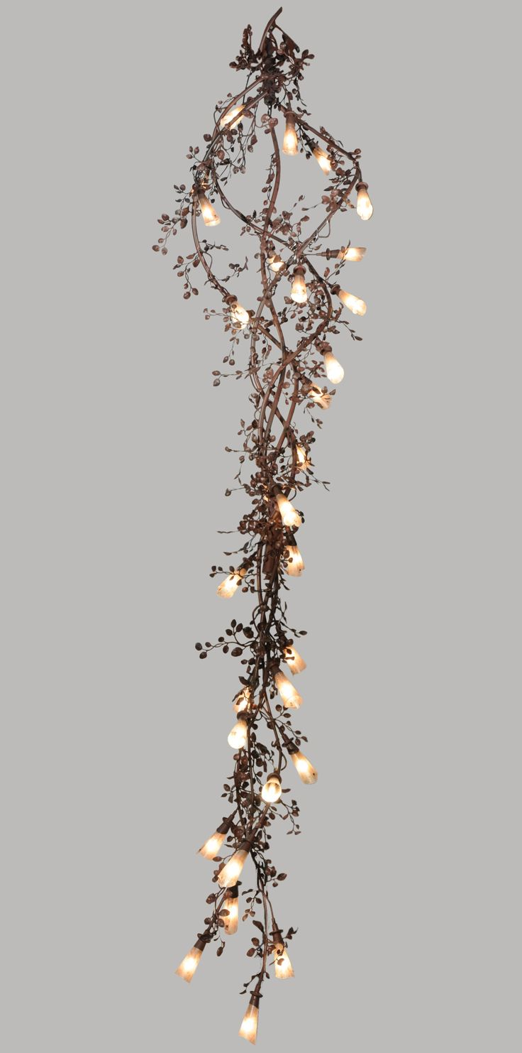 Flower Vine. This 16 ft design  features 30 silver mica trumpet flower  shades entwined with  leaves and vines! Finish:  Rust with wrought iron.