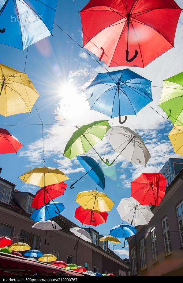 Flying Umbrellas  High resolution model: https://500px.com/photo/212090767  © Rau Hartmann Galaxy  #photography #sky #city #blue #sun #light #buildings #clouds #pretty #colors #fun #windows #umbrellas #fantasy #decoration