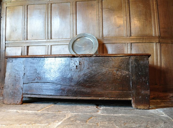 CHESTS / COFFERS - THE SINGLE BOARD WALNUT TOP WITH HEAVY IRON HINGES, ABOVE A FRONT OF A SINGLE PLANK WITH LARGE IRON LOCKPLATE. THE CONSTRUCTION CONSISTS OF FOUR WIDE STILES CARRIED DOWN TO THE FLOOR AS LEGS INTO WHICH LARGE BOARDS ARE TENENED AND PEGGED TO FORM THE
