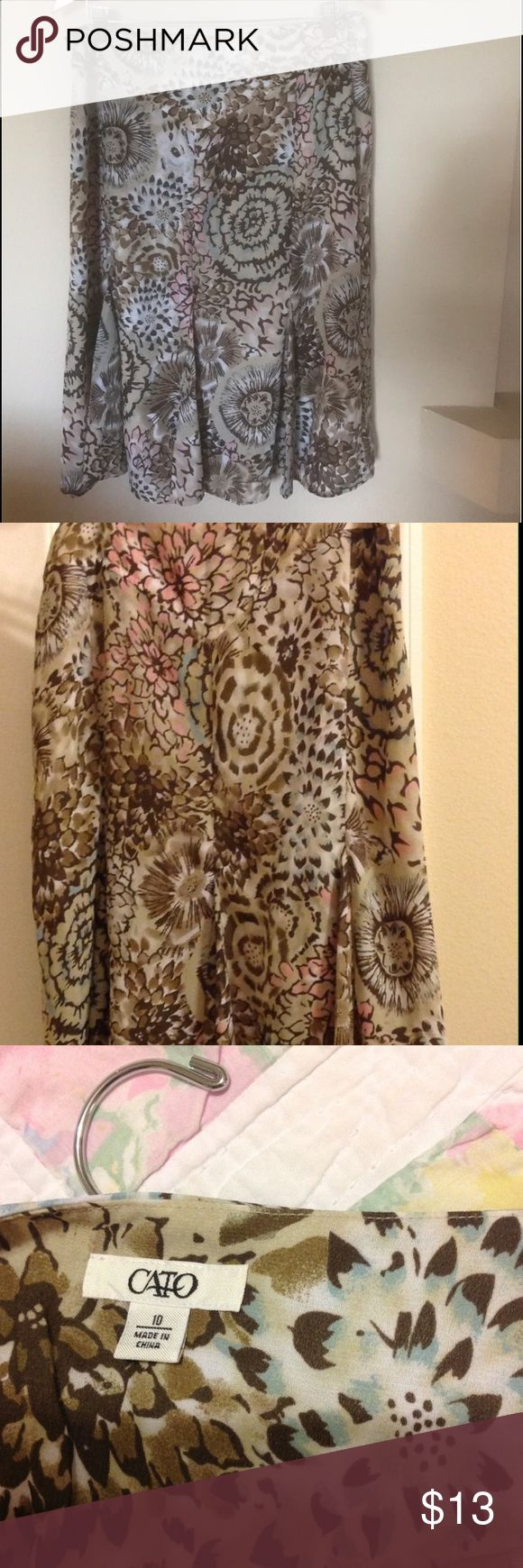 Cato Brown Tan multi color skirt Tan brown pink skirt. Good quality with easy wash instructions. A spring delight to be worn with a light weight top, sweater with just the right shoe and simple accessories. Cato Skirts