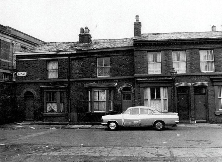 The birth certificate of my grandfather Arthur Andrew Stanley (1892-1969) lists 13 Heber Street, Liverpool, England, as the family residence. The street no longer exists but this photo from the Liverpool Record Office shows how it appeared in the 1960s.