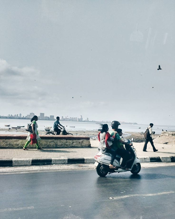 Forever running towards to an invisible finish line that only we can see.  In tones of grey singing the same assembly line song they hummed in school.  If only they told us the saga of the sea and the sky... Maybe we'd be a brighter shade of blue.  #poem #shadesofgrey #poetry #mumbai #india #sea #sky #school #symbolism #story