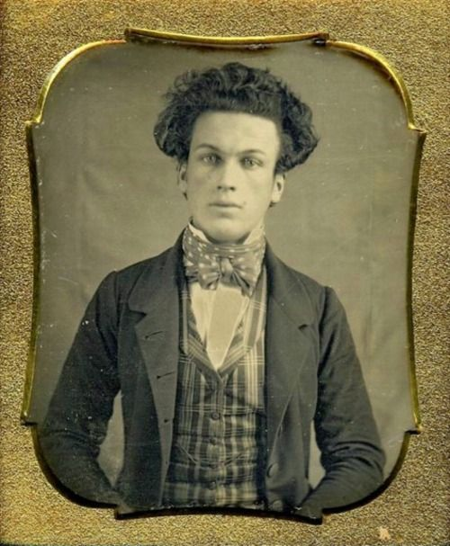 Unknown young man with interesting hairdo!...1855.
