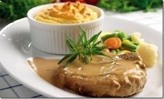 Crock Pot Pork Chops - 4-6 bone in pork chops depending on your family size. - 1 small can cream of mushroom soup (could use cream of chicken as well) - 1 can filled with water or milk depending on how creamy you like your gravy. - For a little more flavoring you can add in one dry mix packet of Ranch Dressing - Cover and cook on low for 4-6 hours. (Do the same thing with chicken instead of pork chops, and leave off the milk/water).