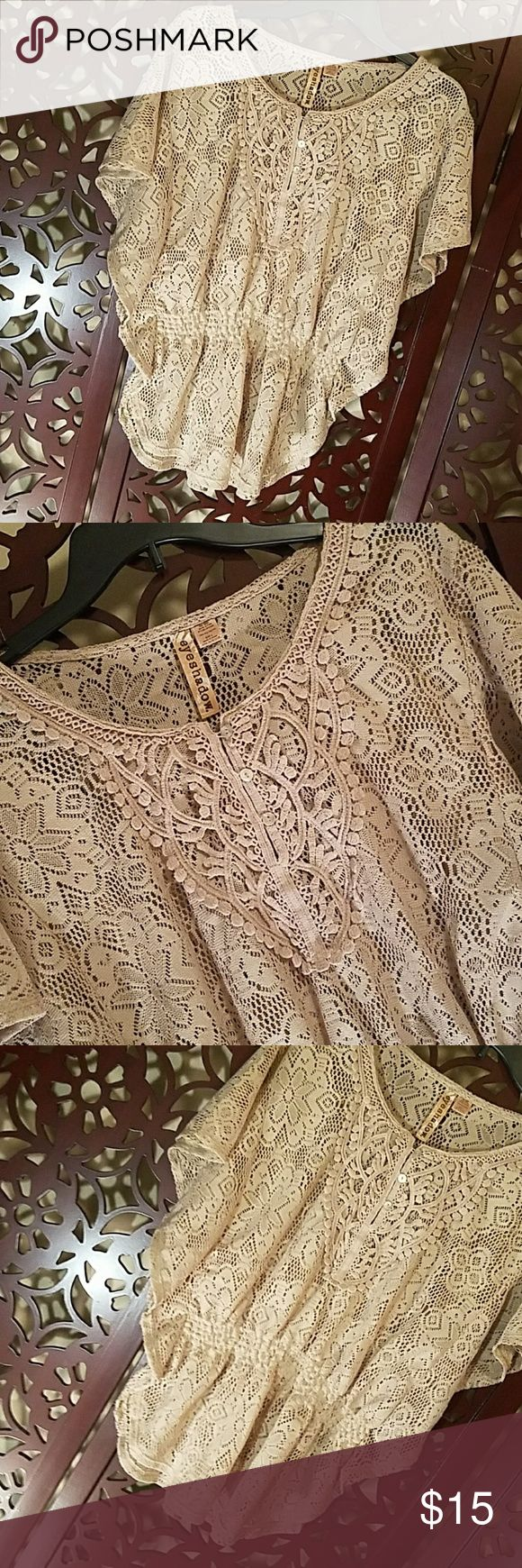 A crocheted like top size LG by Eyeshadow Pics can't do this top justice.  Crochet look, elastic waist,  batwing sleeves,  wear a camisole or tank underneath. In excellent preloved condition.  A dark beige. Eyeshadow Tops