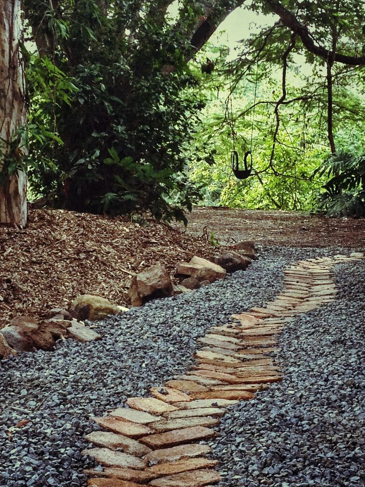 Recycled bricks and 20mm of blue metal gravel were used to make a path and area for storing waste bins. The garden bed edging was made using sandstone rocks from an old climbing wall. A more affordable option compared to a concrete slab or paving!