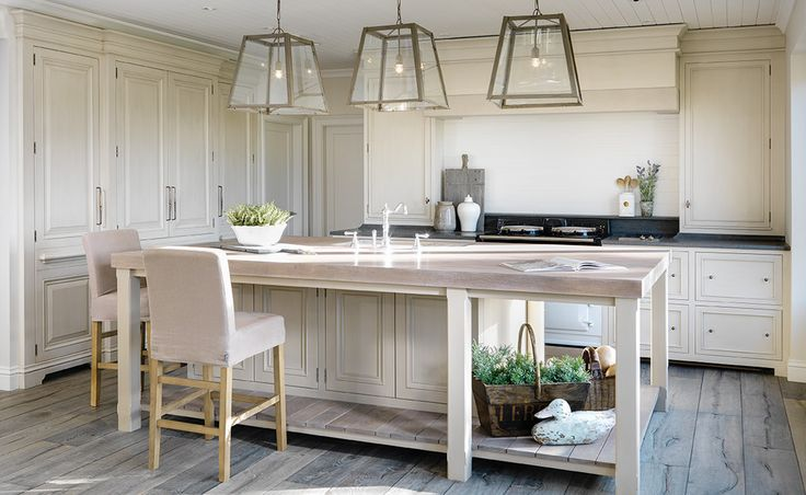 Love this scandinavian style kitchen with rustic light timber floors, pendant lights, joinery with black honed granite bench tops. COASTAL RETREAT - ANDREW RYAN