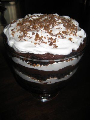 Layer crumbled devil's food cake, then chocolate pudding, then cool whip then heath bar pieces--three times in trifle dish.