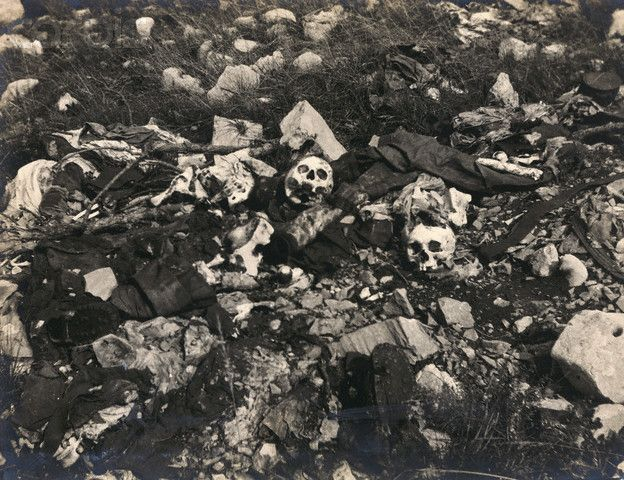 The skeletal remains of Italian soldiers who died on the Carso Plateau during World War I are scattered over a battlefield. The Carso Plateau, although small, was where some of the bloodiest World War I battles between Austria and Italy were fought.