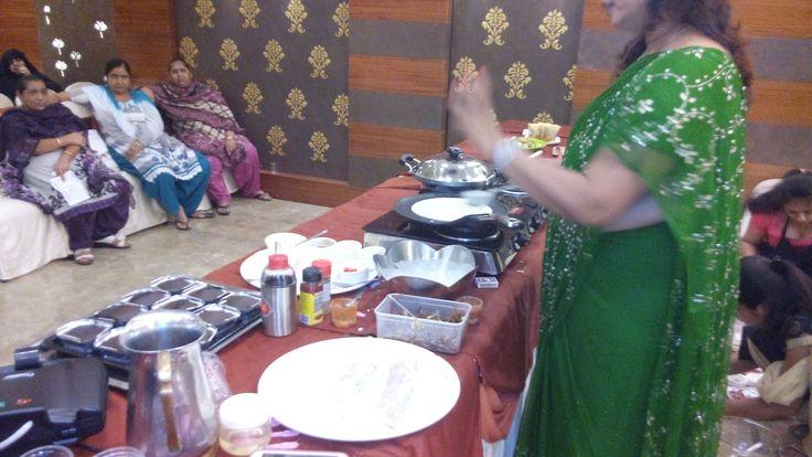 Prestige Bandhan, a multi-cuisine cookery show - held at Prestige Smart Kitchen store, Jamnagar. Chef Kiran Madlani preparing a dish.