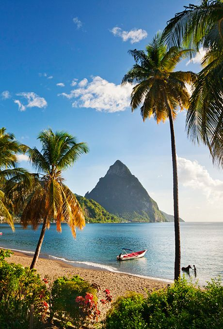 Brides.com: . 12. St. Lucia    St. Lucia is known for its twin green Piton mountains, but it is most famous among the honeymoon set for its own unique indulgence: the three-walled room, which leaves couples in a luxurious yet open-air setting.