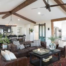 Open Concept Living Space With Exposed Beam Vaulted