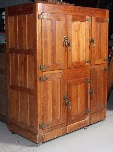 Oak ice box, commercial size, six door with original Bohn brass hardware, nice original condition, metal lined base for ice, - Price Estimate: $500 - $700