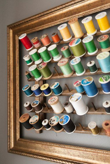 DIY IDEA - Cotton reel framed storage via Apartment Therapy